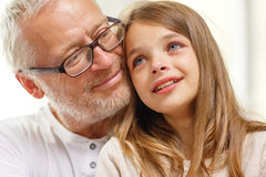 Grandfather with crying granddaughter at home. Family, support, childhood and people concept - grandfather with crying granddaughter at home Royalty Free Stock Photography