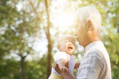 Grandfather and crying grandson. Stock Images