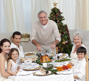 Grandfather cutting turkey for Christmas dinner Stock Photography