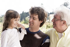 Grandfather, dad and granddaughte Stock Photos