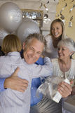 Grandfather Embracing Grandson Royalty Free Stock Image