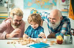 Free Grandfather Father And Cute Little Son Having Fun At Home. Parenting Childhood Values Weekend. Male Multi Generation Stock Photo - 172835640