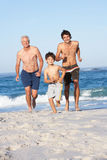 Grandfather, Father and Grandson Running. Along Beach Royalty Free Stock Photography
