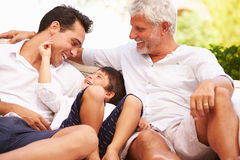 Grandfather,Father And Grandson Sitting Outdoors At Home Royalty Free Stock Photos