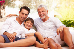 Grandfather,Father And Grandson Sitting Outdoors At Home Royalty Free Stock Photo