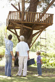 Grandfather, Father And Son Building Tree House Together Stock Photography
