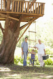 Grandfather, Father And Son Building Tree House Together Royalty Free Stock Image