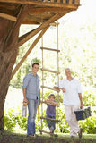 Grandfather, Father And Son Building Tree House Together Stock Photo