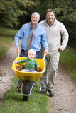 Grandfather and father taking grandson for walk Royalty Free Stock Photos