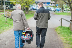 Grandfather and Father walking with little baby son Royalty Free Stock Images