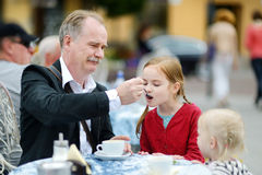 Grandfather feeding frothy milk to his grandchild Stock Photo