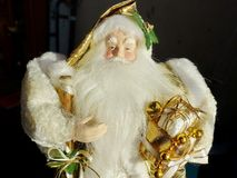 Grandfather Frost Santa Claus, St. Nicholas, Joulupukki with presents on a black background. The symbol of the New year and Christmas royalty free stock photos