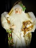 Grandfather Frost Santa Claus, St. Nicholas, Joulupukki with presents on a black background. The symbol of the New year. And Christmas stock photo