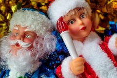 Grandfather frost and snow maiden with a toy in the hand of the snow maiden torch Royalty Free Stock Photography