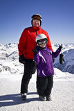 Grandfather and girl enjoying winter sports. In solden, austria Royalty Free Stock Images