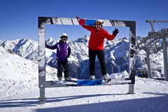 Grandfather and girl enjoying winter sports. In solden, austria Stock Images