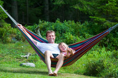 Grandfather and girl in hammock royalty free stock photos