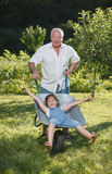 Grandfather giving granddaughter ride Royalty Free Stock Photography