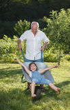 Grandfather giving granddaughter ride Stock Photography