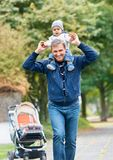 Grandfather Giving Grandson Ride On Back Royalty Free Stock Photography