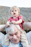Grandfather Giving Grandson Ride On Shoulders Outdoors Royalty Free Stock Image