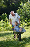 Grandfather giving grandson Royalty Free Stock Image