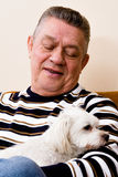 Grandfather giving his dog a loving look Royalty Free Stock Photography