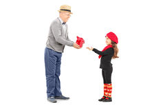 Grandfather giving present to his little niece Royalty Free Stock Image
