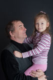 Grandfather with the grand daughter Stock Photography