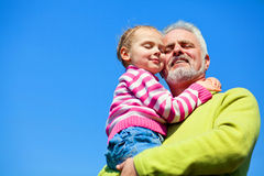 Grandfather and grandaugther. Happy together Royalty Free Stock Image