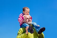 Grandfather and grandaugther. Grandfather and grandchild happy together Stock Photo