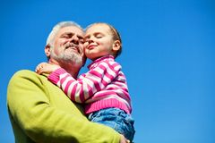 Grandfather and grandaugther. Grandfather and grandchild happy together Royalty Free Stock Photo