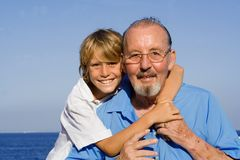Grandfather and grandchild. Happy smiling grandfather and grandchild royalty free stock photo