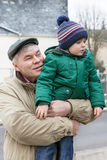 Grandfather with grandchild having fun outdoors. Stock Photography