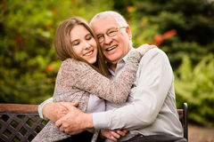 Grandfather and grandchild hug Stock Images