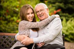 Grandfather and grandchild hug Stock Photos