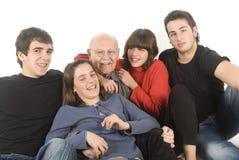 Grandfather and grandchildren. Grandfather having fun with grandchildren Stock Photo