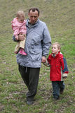 Grandfather with grandchildren. Walk royalty free stock photography