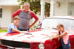 Grandfather With Grandchildren Cleaning Restored Classic Car Stock Photography