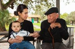 Grandfather and Grandchildren Stock Photography
