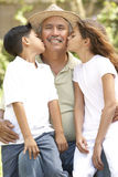 Grandfather With Grandchildren In Garden Royalty Free Stock Photos