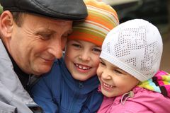 Grandfather with grandchildren outdoor Stock Photos