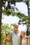 Grandfather With Grandchildren In Park Stock Photos