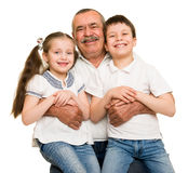 Grandfather and grandchildren portrait. Studio shoot stock images