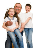 Grandfather and grandchildren portrait. Studio shoot royalty free stock images