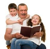 Grandfather and grandchildren portrait. Studio shoot stock image