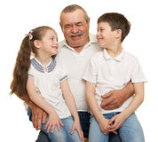 Grandfather and grandchildren portrait. Studio shoot stock photo