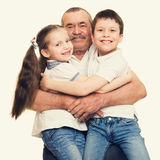 Grandfather and grandchildren portrait. Studio shoot stock photos