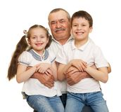 Grandfather and grandchildren portrait studio shoot. Grandfather and grandchildren portrait on white stock photography