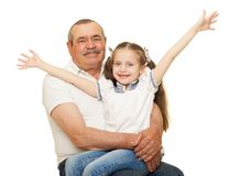 Grandfather and grandchildren portrait studio shoot. Grandfather and grandchildren portrait on white royalty free stock images